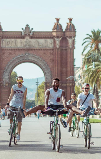 friends-riding-bike-barcelona