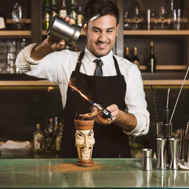 Barman making a tiki cocktail