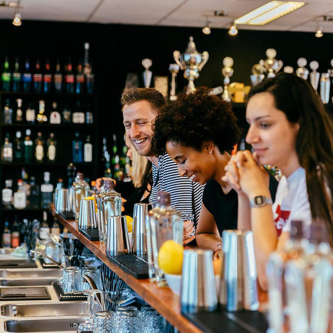people smiling in bartender school in Amsterdam