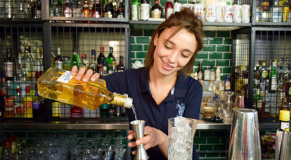 Student behind the bar